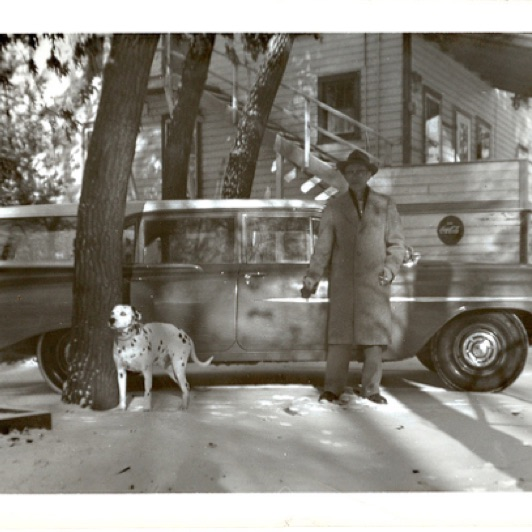 Here's a shot of Mr. Pfaff with his dog. He was  3 owners back. Notice the stairs going up the front of the lodge.