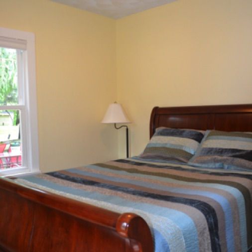 The main level bedroom has a queen bed and a 32 inch TV.