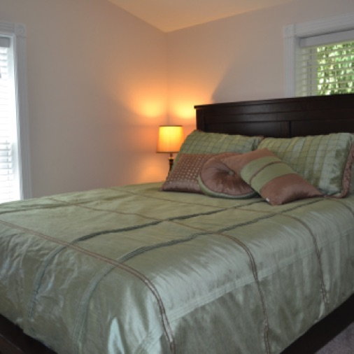 This bedroom is also on the second level and has a queen bed.