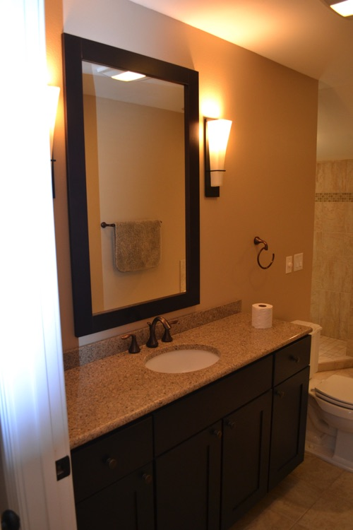 The master bath has a corner tub, separate shower and 60 inch vanity.